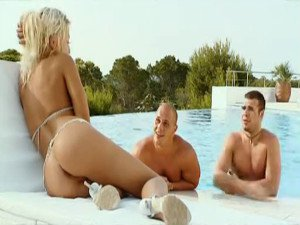 Sexy blonde threesome at pool