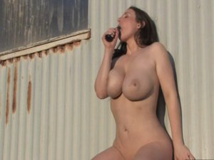 Busty brunette masturbating outdoors