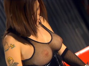 Allie in fishnet lingerie and a shiny latex corset