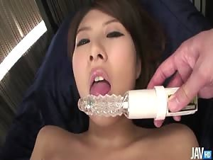 Mai Asahina oils up her succulant body and plays with her trimmed pussy