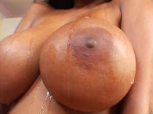 Latina lady demonstrates her huge breast and starts sucking