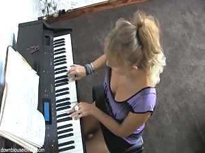 Blonde Melissa playing piano