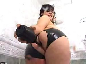 Kinky brunette lets a guy piss in her ass