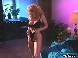 Curly blonde gives a striptease