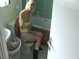 Britney smoking a cig on the toilet