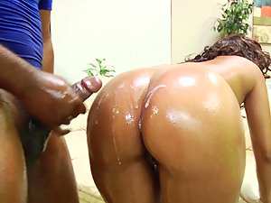 Cocoa Dawn gets her oily ass covered in cum