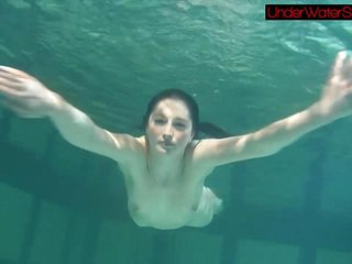 Blackhaired beauty Irina underwater