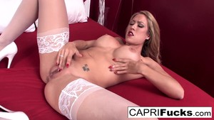Athletic Capri plays with her pussy on her bed