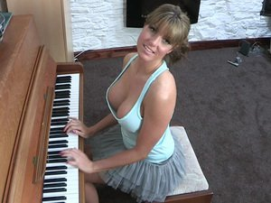 Busty Talia at the piano