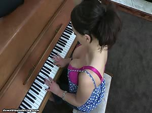 Busty Vickie playing the piano